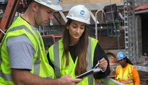 Two construction professionals discussing job plans